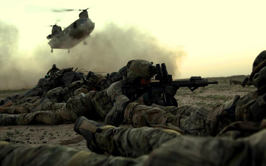In this file photo from November 2013, Rangers from 1st Battalion, 75th Ranger Regiment, as part of a combined Afghan and coalition security force operating in Ghazni province, Afghanistan, await a CH-47 for extraction.