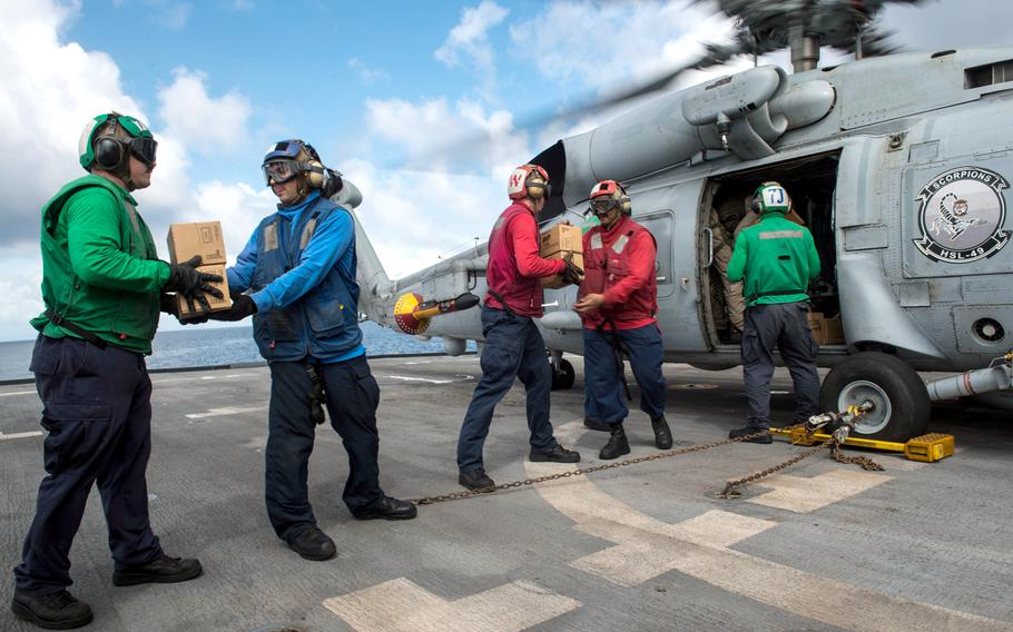 U.S. Sailors assigned to the littoral combat ship USS Freedom pack the cabin of an MH-60R Seahawk helicopter assigned to Helicopter Maritime Strike Squadron 73 with relief supplies from Project Handclasp Nov. 24, 2013, in Leyte Gulf, Philippines, during Operation Damayan.