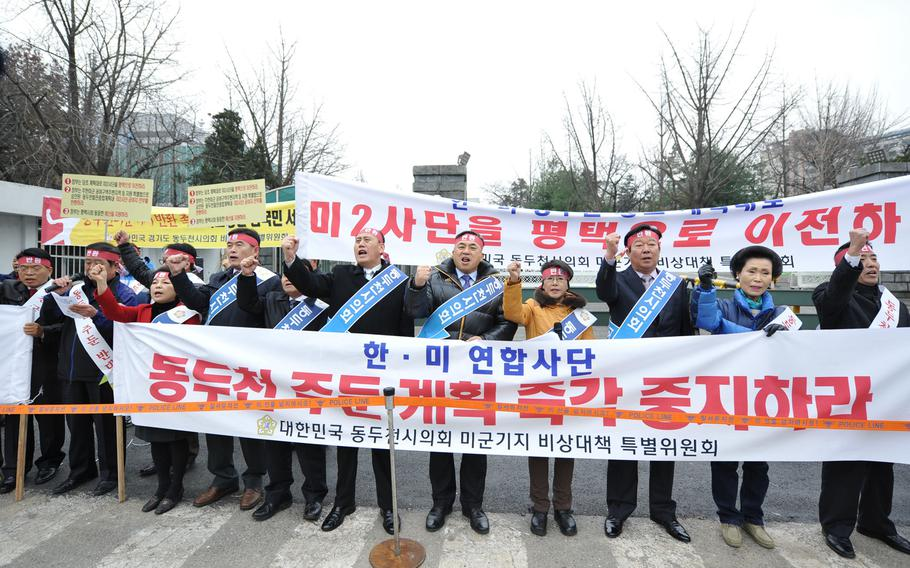 Dongducheon residents and members of the Dongucheon City Council protest the possible long-term presence of U.S. soldiers in their city Monday, Dec. 2, 2013, in front of the Ministry of National Defense headquarters in Seoul.