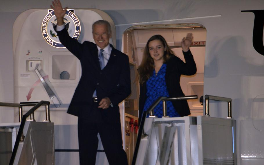 U.S. Vice President Joe Biden waves to South Korean media on arrival at Osan Air Base, South Korea, on Dec. 5, 2013. Biden was scheduled to meet with the South Korean president during his visit.