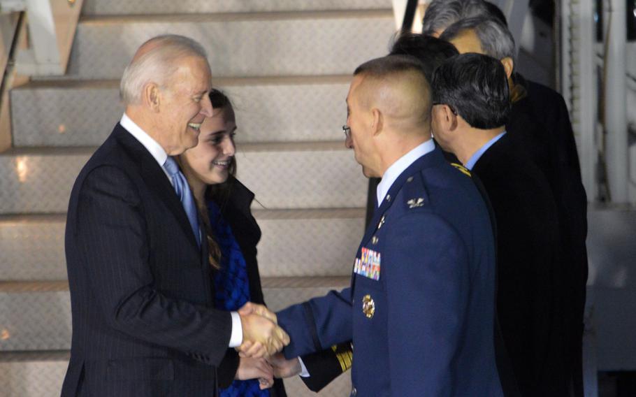U.S. Vice President Joe Biden shakes hands with Col. Brook J. Leonard, 51st Fighter Wing Commander, at Osan Air Base, South Korea, on Dec. 5, 2013.