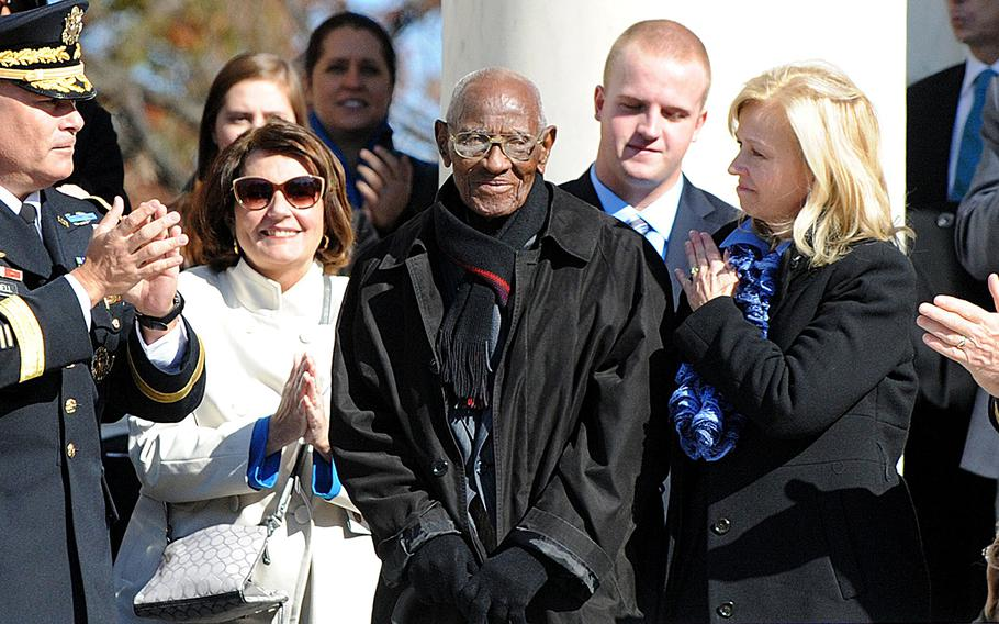 Richard Overton, who is believed to be the oldest living World War II veteran is acknowledged by U.S. President Barack Obama during a ceremony to honor veterans at the Tomb of the Unknowns at Arlington National Cemetery on November 11, 2013 in Arlington, Virginia.