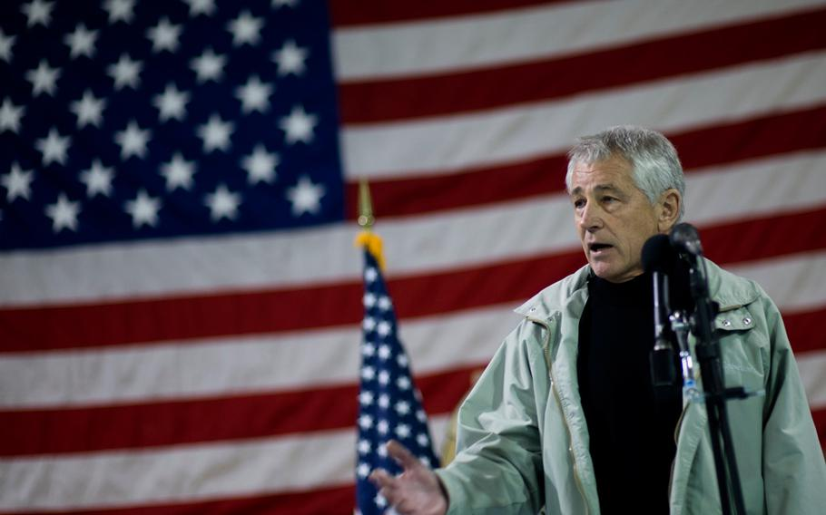 U.S. Defense Secretary Chuck Hagel speaks to troops and officials at Camp Leatherneck in the Helmand province of Afghanistan, Dec. 8, 2013.