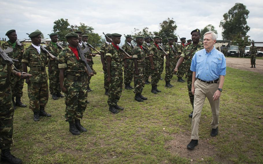 Secretary of the Navy Ray Mabus reviews Burundi National Defense Force (BNDF) troops during a visit to Bujumbura, Burundi, Nov. 21, 2013. A Pentagon spokesman said Dec. 9, 2013 that 850 Burundian troops will be airlifted from Burundi to CAR in U.S. C-17s for a peacekeeping mission in the Central African Republic.