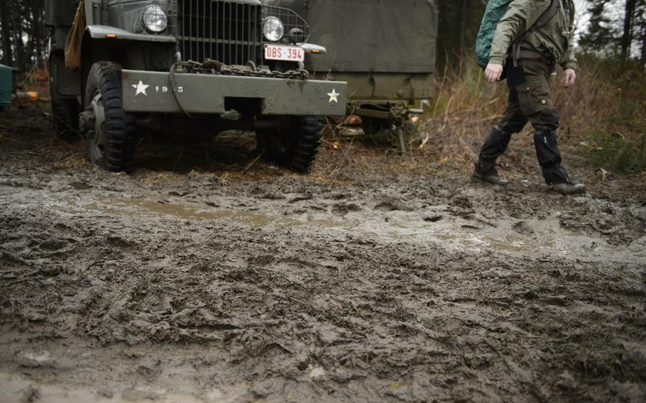 A supply truck sits in mud along the route of the Bastogne Historic Walk Dec. 15, 2012. There were three routes participants could walk: 7, 13 or 22 kilometers. The trails quickly turned soggy as thousands of participants walked the perimeter of the town.