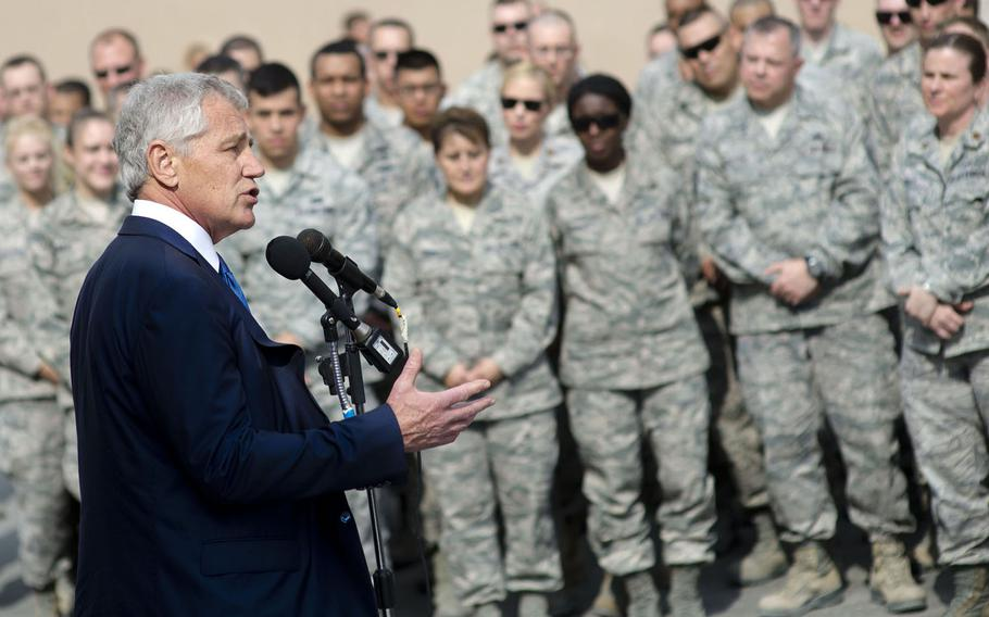 U.S. Defense Secretary Chuck Hagel, left, addresses troops on Al Udeid Air Base, Qatar, Dec. 10, 2013. Hagel thanked the troops for their service, took several questions and posed for personal pictures with the service members.