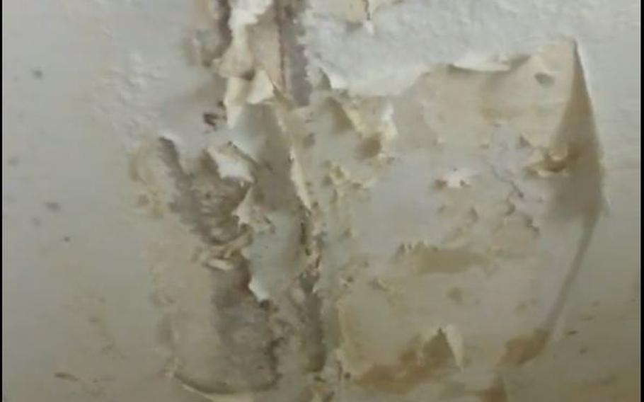 The paint on the ceiling in the bathroom is come off at Fort Polk, Louisiana, in this screen shot from a video uploaded to Facebook, illustrating some of the deteriorating conditions at the base.