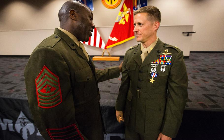 Sgt. Maj. Ronald L. Green congratulates Maj. Robb McDonald after a ceremony Dec. 9, 2013, at Camp Pendleton, Calif., where McDonald received the Silver Star for his actions while deployed to Camp Bastion, Afghanistan in 2012.