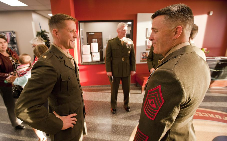 Maj. Robb McDonald speaks with a fellow Marine during a ceremony at Camp Pendleton, Calif., where he received the Silver Star for his efforts against an enemy attack at Camp Bastion, Afghanistan in 2012.