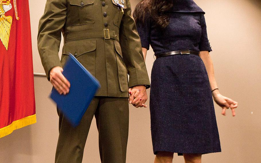 Maj. Robb McDonald stands with his wife, Jennifer, during a ceremony Dec. 9, 2013, at Camp Pendleton, Calif., where the Marine Corps officer received the Silver Star for his efforts against an enemy attack aboard Camp Bastion, Afghanistan in 2012.