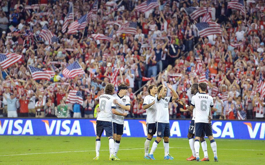 USA players congratulate each other after scoring a second goal against Jamaica in the second half of a World Cup qualifying match at Sporting Park in Kansas City, Kansas, Oct. 11, 2013. The USA defeated Jamaica, 2-0.