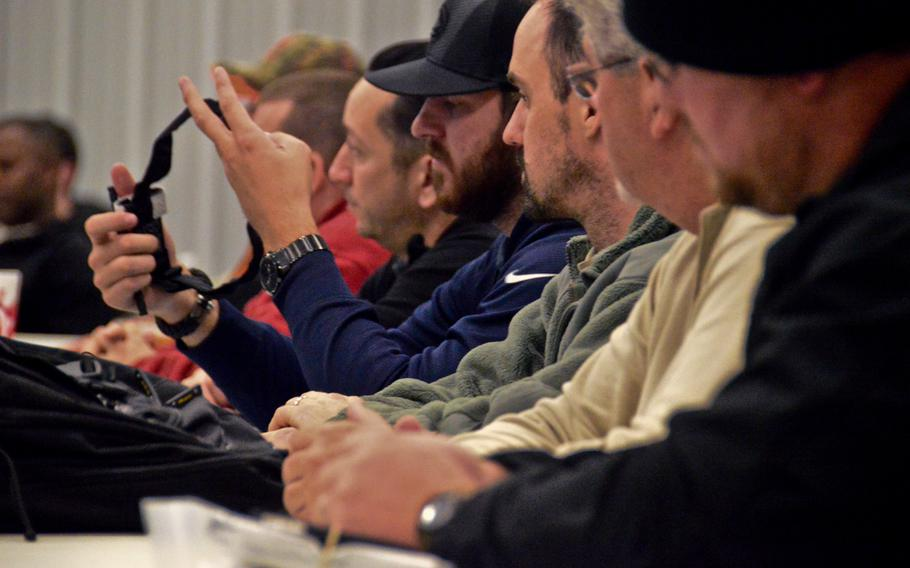 Civilian contractors participate in familiarization classes on personal protective equipment at the Camp Atterbury on Nov. 20, 2013. (Photo by , Atterbury-Muscatatuck Public Affairs)