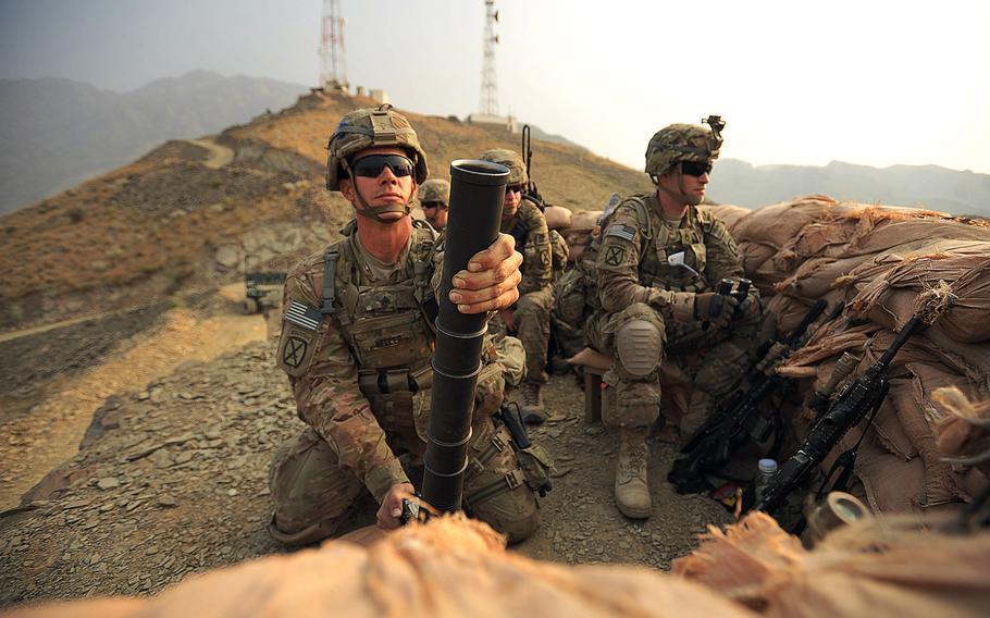 U.S. Army Sgt. John Keller balances his M224 60mm mortar on Forward Operating Base Torkham, on Sept. 27, 2013.