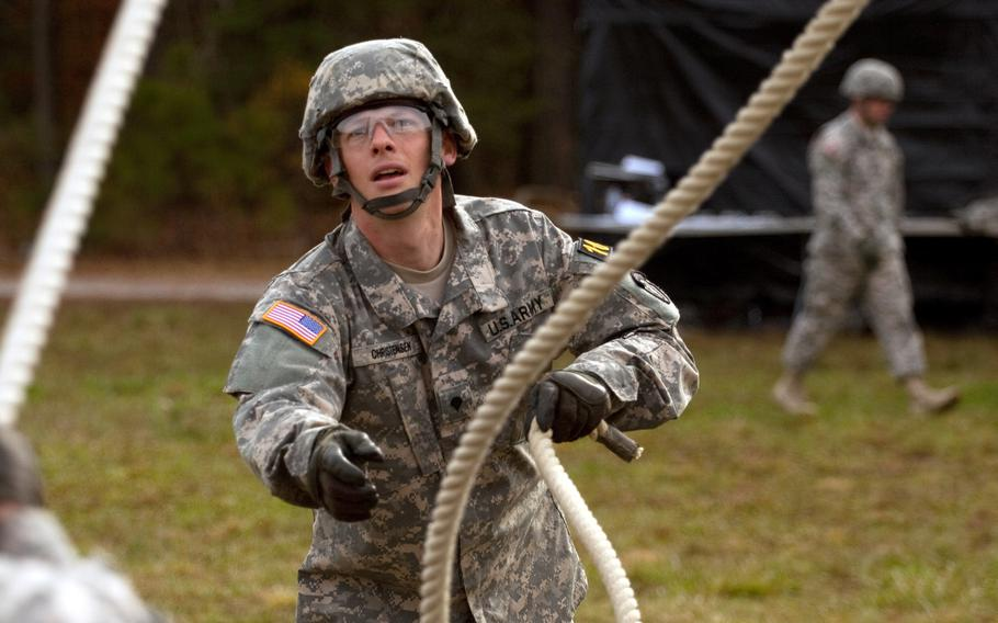 Spc. Adam Christensen participates in the leadership reaction course event as a part of the 2013 Army Best Warrior Competition at Fort Lee, Va., on Nov. 21, 2013.  Christensen went on to win the award for soldier of the year at the competition.