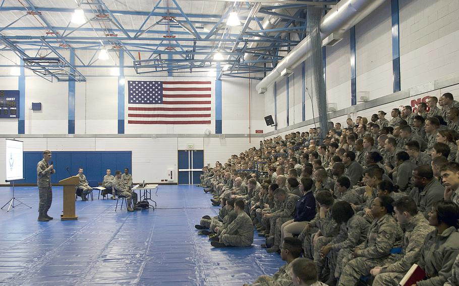 Maj. Ryan Richardson, 48th Support Squadron commander, conducts a town-hall meeting at RAF Lakenheath, England, on Monday, Dec. 16, 2013, to discuss Air Force personnel cuts. The pending cuts are part of an effort by the Air Force to deal with fiscal restraints imposed by sequestration.
