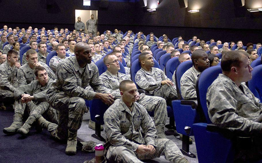 The first, announced meeting about force reduction at RAF Mildenhall, England, had so many attendees that some airmen sat in the theater's aisle on Wednesday, Dec. 18, 2013. Meetings have been announced at Air Force bases around the world to discuss the recent announcement that up to 25,000 active duty slots would be cut.