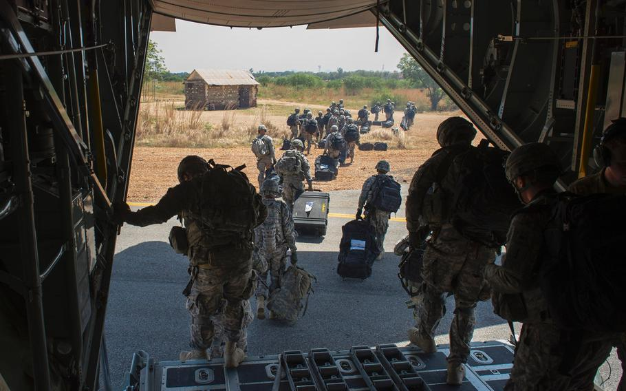 U.S. troops with Combined Joint Task Force-Horn of Africa's East Africa Response Force depart an U.S. Air Force C-130 Hercules from Camp Lemonnier, Djibouti, on Dec. 18, 2013. The EARF deployed to South Sudan supporting the ordered departure of the U.S. Embassy.