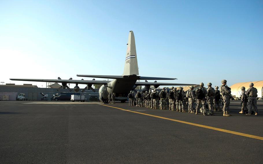 U.S. troops with Combined Joint Task Force-Horn of Africa's East Africa Response Force load onto a C-130 Hercules at Camp Lemonnier, Djibouti, on Dec. 18, 2013. The EARF deployed to South Sudan supporting the ordered departure of the U.S. Embassy.