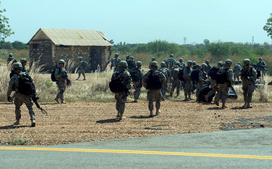 U.S. troops with the East Africa Response Force depart a C-130 Hercules at Juba, South Sudan, on Dec. 18, 2013.