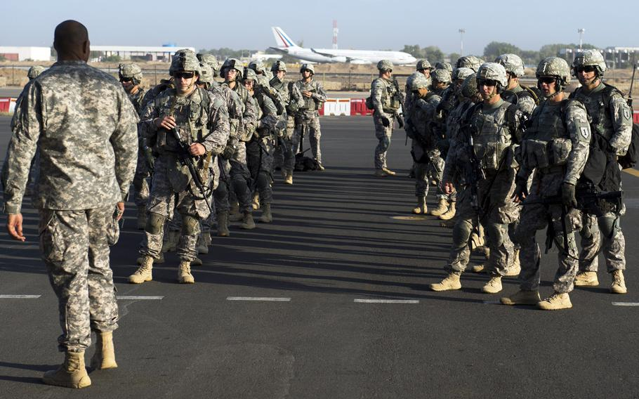 Soldiers of the East Africa Response Force prepare to load onto a U.S. Air Force C-130 Hercules at Camp Lemonnier, Djibouti, for departure to Juba, South Sudan, Dec. 18, 2013.