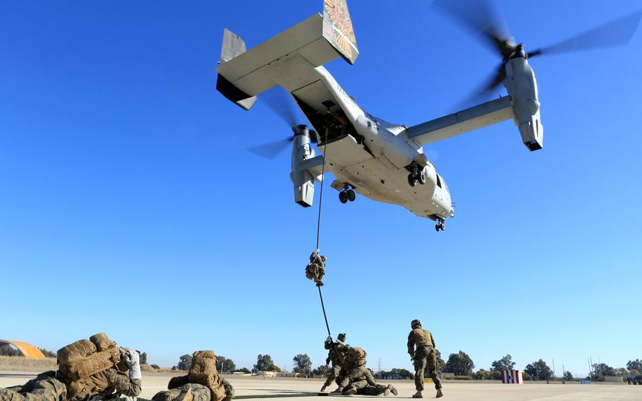 Marines and sailors with Special-Purpose Marine Air-Ground Task Force Crisis Response conduct helicopter rope suspension training from an MV-22B Osprey at Morón Air Base, Spain, Dec. 6, 2013.