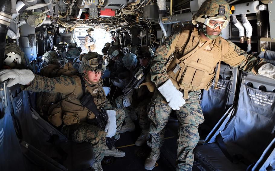 Marines and sailors with Special-Purpose Marine Air-Ground Task Force Crisis Response prepare to conduct helicopter rope suspension training from an MV-22B Osprey at Morón Air Base, Spain, Dec. 6, 2013.