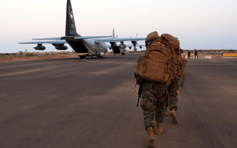 U.S. Marines and sailors prepare to load onto a KC-130J Marine Super Hercules at Camp Lemonnier, Djibouti, in this file photo from Dec. 24, 2013.