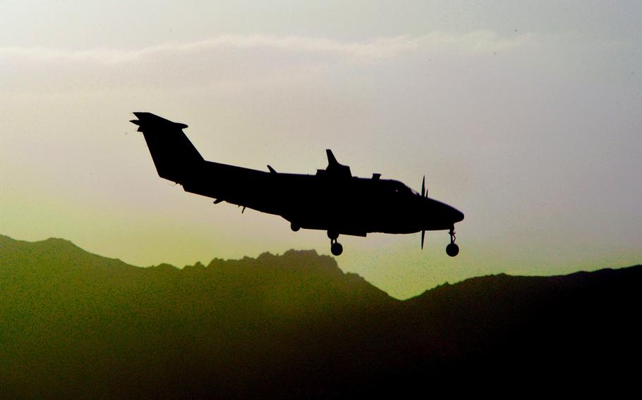 An MC-12 prepares to land at Bagram Air Field, Afghanistan, on Aug. 14, 2013. According to an ABC News report citing an unnamed defense official, an MC-12 crashed in Afghanistan on Friday killing three on board.