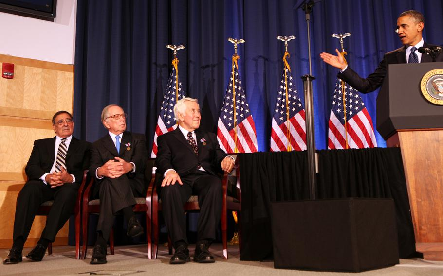 U.S. President Barack Obama delivers remarks to the Nunn-Lugar Cooperative Threat Reduction symposium at the National Defense University for the 20th anniversary of the CTR program while then Secretary of Defense Leon Panetta, left, former Senator Sam Nunn, second from left, and Senator Dick Lugar, second from right, listen in Washington, D.C., Dec. 3, 2012. In his speech, the president acknowledged the extraordinary progress made in securing nuclear material, and thanked Senators Nunn and Lugar for their works on those issues.