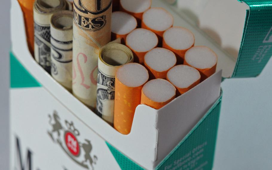 According to data available in April 2010, Americans spend each year more than $50 billion on cigarettes, essentially smoking their money away.  Roughly 30% of military active duty personnel smoke, and the Department of Defense health care system spends roughly $930 million dollars on smoking-related illnesses. This photo won honorable mention as an illustrative in the 2011 Military Photographer of the Year competition.
