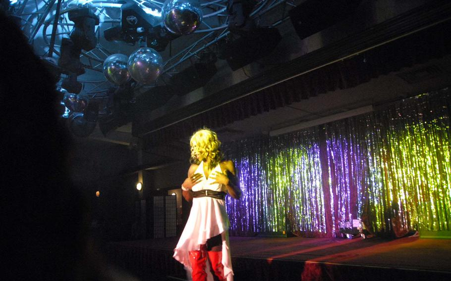 Drag queen Chocolate Sunrise, a pseudonym used by Senior Airman Brandon Smith, performs in a fundraiser to support lesbian, gay, bisexual and transgender troops Saturday at Kadena Air Base, Japan.