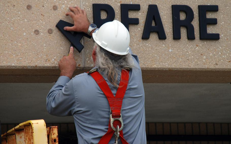 Brian Brehm, facilities manager for Naval Station Ingleside, Texas, removes the letters from Mine Warfare Training Center in 2009. In its 2005 BRAC recommendation, the Defense Department recommended that the center be consolidated with Fleet Anti-submarine Warfare Training Center in San Diego, and many of its employees were moved there.