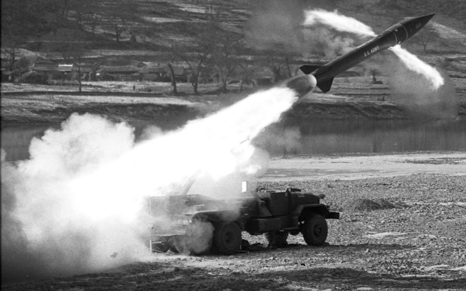 An Honest John missile streaks away from its launcher, bound for a target 13 miles away, during testing in Korea in 1969.