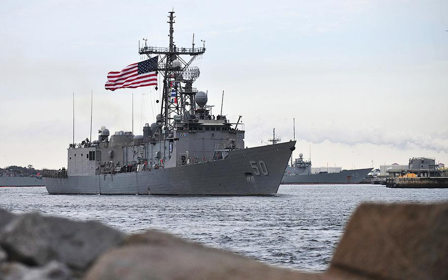 The guided-missile frigate USS Taylor departs Naval Station Mayport for a seven-month deployment to the U.S. 5th and 6th Fleet areas of responsibility Jan. 8, 2014.