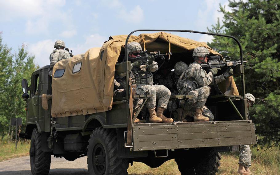 Paratroopers from Attack Company, 1st Battalion, 503rd Infantry Regiment, 173rd Infantry Brigade Combat Team (Airborne) provide security from a vehicle during a tactical control point exercise July 10, 2013, during Exercise Rapid Trident in Yavoriv, Ukraine.
