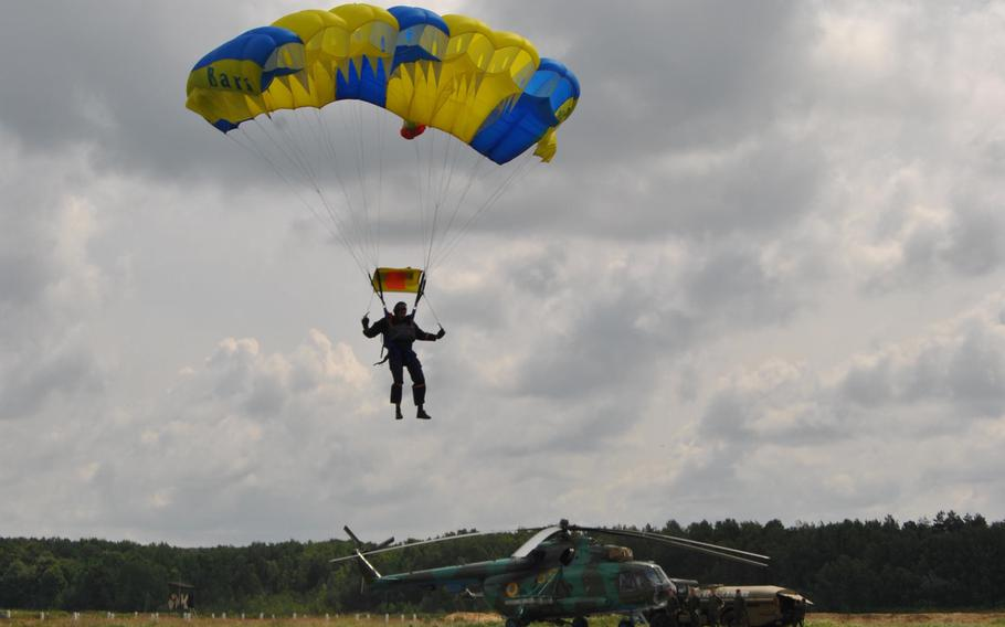 A Ukrainian paratrooper prepares to land during a casualty evacuation demonstration July 15,  2013, during Exercise Rapid Trident in Yavoriv, Ukraine.