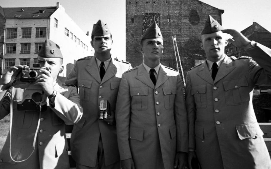 Checking out the area around Berlin's Checkpoint Charlie in 1964 are West Point cadets Steven Harmon, Dan Steinwald, Frank Prokop and William Hecker, left to right.