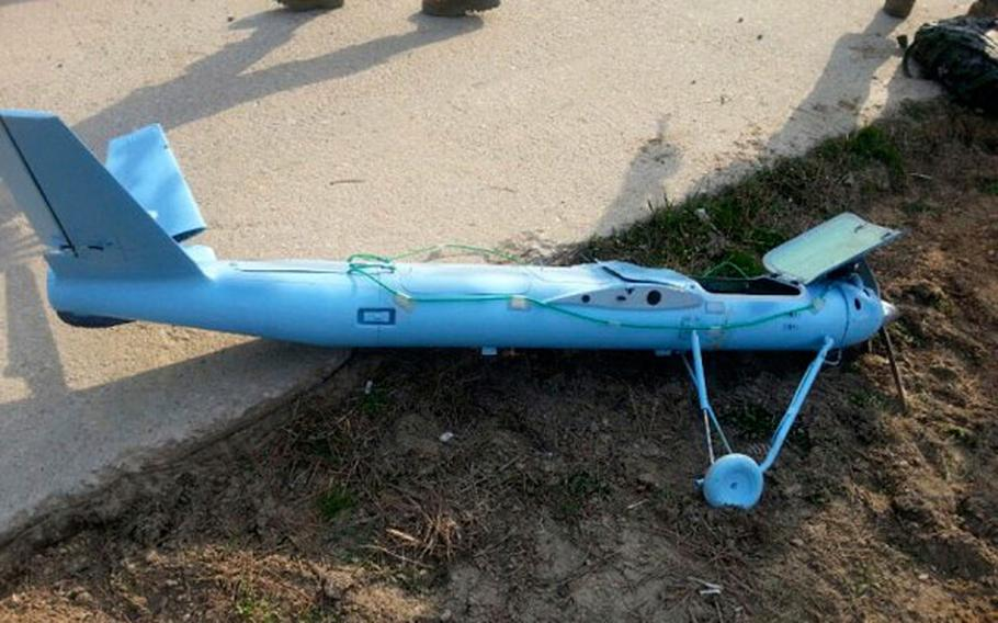 A damaged drone is seen on the ground on Baengnyeong Island, South Korea, in this photo released by the South Korea Defense Ministry on Wednesday, April 2, 2014.
