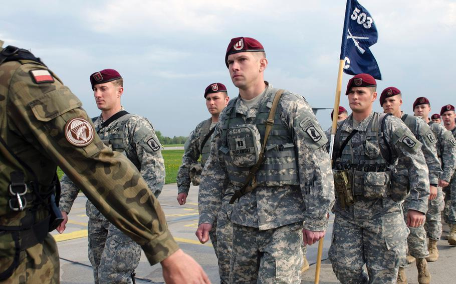 Paratroopers from U.S. Army Europe's 173rd Infantry Brigade Combat Team (Airborne) stand in formation with their partners from the Polish army's 6th Airborne Brigade, on April 23, 2014, at the start of a training rotation with Polish forces.