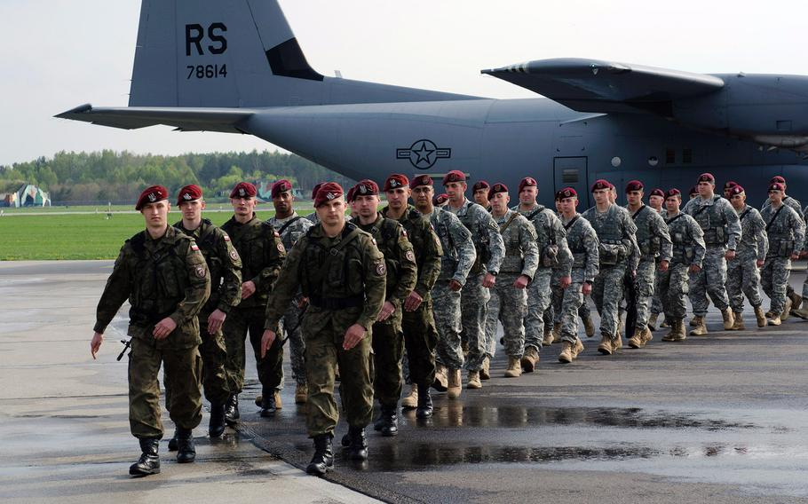 Paratroopers from U.S. Army Europe's 173rd Infantry Brigade Combat Team (Airborne) march in formation with their partners from the Polish army's 6th Airborne Brigade, on April 23, 2014, at the start of a training rotation with Polish forces.