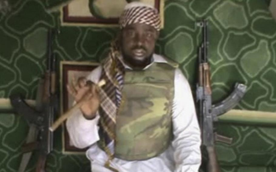 This file image made available Wednesday, Jan. 10, 2012, taken from video posted by Boko Haram sympathizers, shows the leader of the radical Islamist sect Imam Abubakar Shekau. Boko Haram has claimed responsibility for the April 15, 2014, mass abduction of nearly 300 teenage schoolgirls in northeast Nigeria.