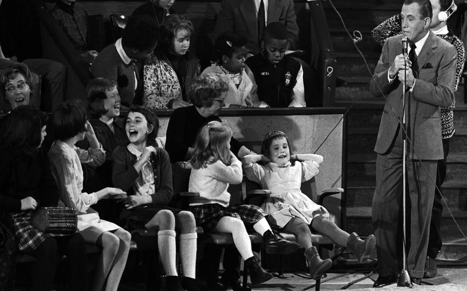 Ed Sullivan with audience members at the Circus Krone in Munich in November, 1965.