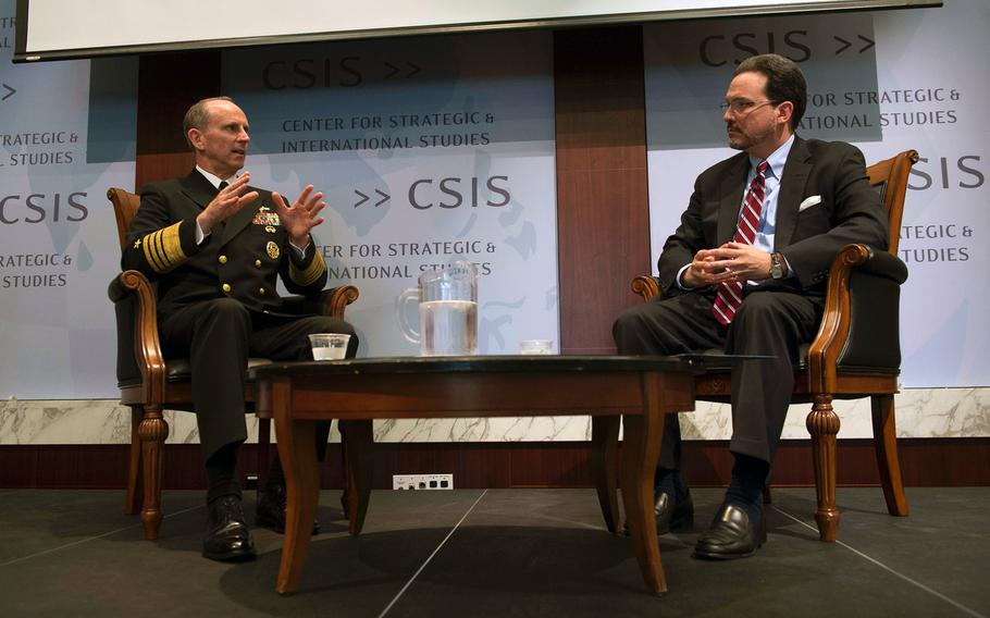 In this file photo from May 19, 2014, Chief of Naval Operations Adm. Jonathan Greenert speaks with Mike Green, vice president of Asia and Japan studies at the Center for Strategic and International Studies, about the Navy's rebalance to the Asia-Pacific region during a conference in Washington, D.C.