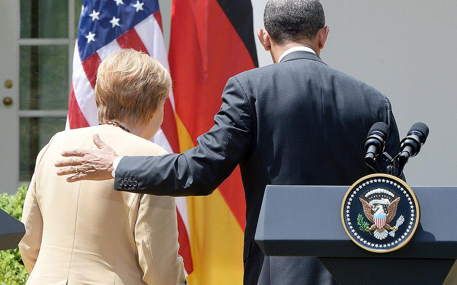 German Chancellor Angela Merkel and President Barack Obama leave the Rose Garden of the White House after speaking on Friday, May 2, 2014.