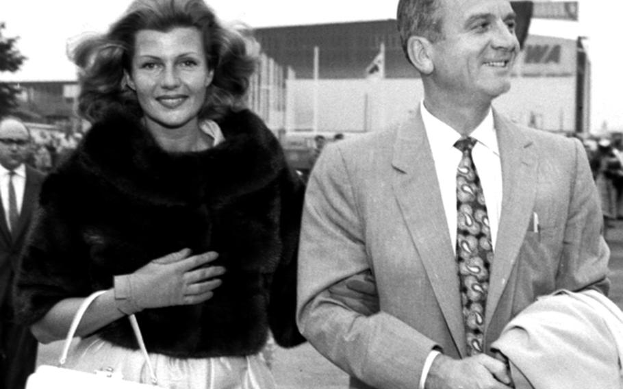 Actress Rita Hayworth and her husband, producer James Hill, arrive in Frankfurt from the U.S. on their way to Berlin in June, 1959.