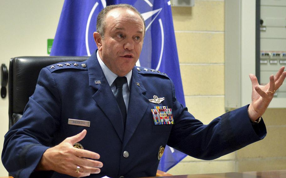 Gen. Philip M. Breedlove, commander of U.S. European Command and Supreme Allied Commander Europe, speaks to reporters following a command change ceremony in Lago Patria, Italy, on July 22, 2014.