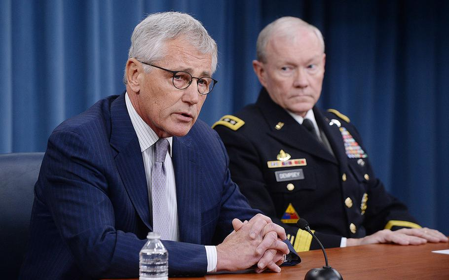 Secretary of Defense Chuck Hagel and Chairman of the Joint Chiefs of Staff Gen. Martin E. Dempsey conduct a briefing on Iraq in the Pentagon Briefing Room on Aug. 21, 2014.