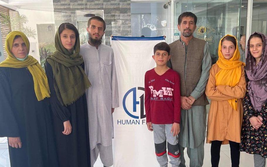 Aman Khalili, third from right, had been in hiding in the weeks after Kabul's fall to the Taliban in mid-August and the U.S. withdrawal from the country. Khalili and his family were rescued last week in a joint effort by a group of Arizona military veterans, aid organizations and the Department of State.