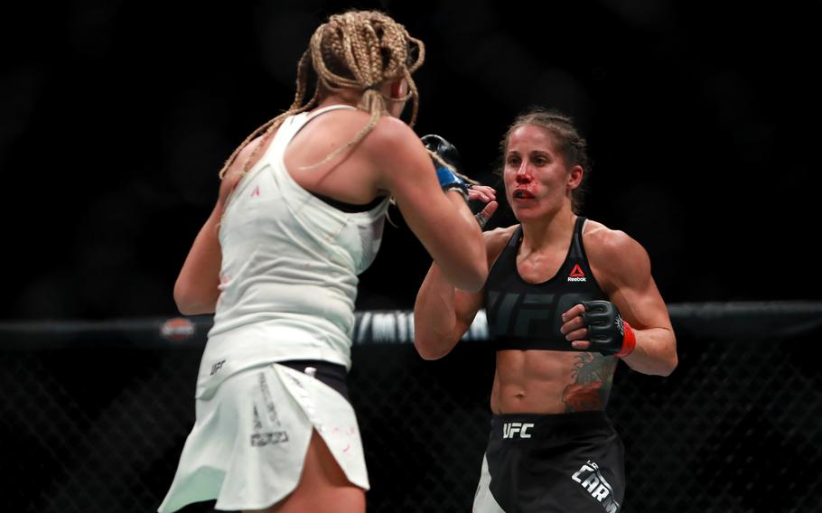 Liz Carmouche of the United States, right, fights against Katlyn Chookagian of the United States in their women's bantamweight bout during the UFC 205 event at Madison Square Garden on Nov. 12, 2016 in New York City.