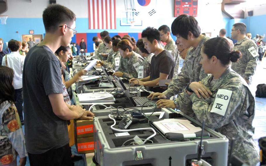 U.S. military dependents, contractors, retirees in Area 4 participate in the Courageous Channel exercise at the Kelly Fitness Center on Camp Walker, South Korea, in May 2012.